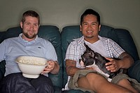 Gay Couple Watching TV with Boston Terrier