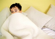 Boy Playing in Bed Sheets