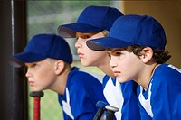 Young baseball players sitting on bench