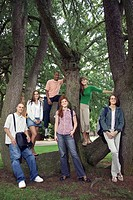 College students posing by tree