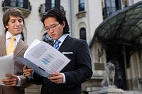 Businessmen reading documents