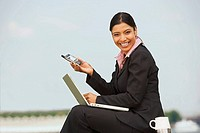 Woman with laptop and PDA