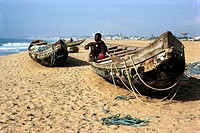 Togo, near Lomé, pirogues and fisherman