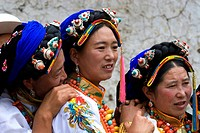 China, Sichuan, near Danba, Tibetan village festival, women with traditional headdress