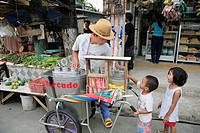 PHILIPPINES  Ice cream seller   Scene in a street market at Bagong Silangan,  Quezon City, Manila