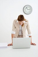 Woman standing in front of the laptop