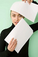 business woman covering face by document