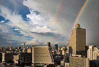 Double rainbow over Bangkok, Thailand. The Shangri La hotel on the Chao Phraya river is in the middle foreground. The Oriental hotel is to the left of...