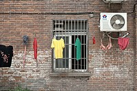 Colorful clothes drying outside a brick building, Chinese laundry, Nanjing, China