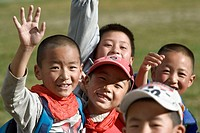 Chinese schoolboys waving, Shangri La Zhongdian, Yunnan, China
