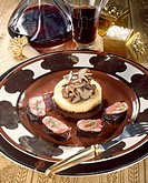 Small pieces of lamb with polenta and shiitake