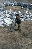 Young boy playing with a wheel