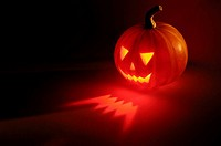Jack-o-lantern, Halloween holiday symbol, illuminated from inside leaving scary lights