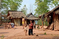 Poverty, children in a village, simple huts, Xieng Khuang Province, Laos, Southeast Asia