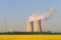 Grafenrheinfeld Nuclear Power Station behind a field of flowering rapeseed, Grafenrheinfeld, Lower Franconia, Bavaria, Germany, Europe