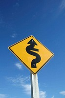 Yellow road sign: winding street, Hwy 75, Little River, Akaroa, East Coast, South Island, New Zealand