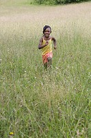 African girl running in field