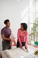 African man asking wife about bold wallpaper