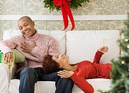 African couple drinking Champagne at Christmastime