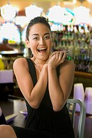 Excited mixed race woman in casino