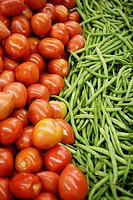 Tomatoes &amp; green beans on display in market