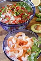 Bowl of shrimp, another of diced peppers, onions, & tomatoes. Ingredients for Ceviche.