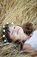 Portrait of a young girl laying in the countryside