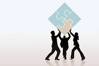 Businesspeople lifting puzzle pieces