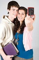 Teen couple taking photograph