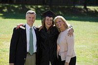 Woman with parents on graduation day
