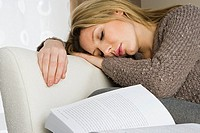 Woman sleeping with book (thumbnail)