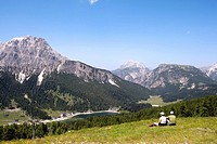 Hikers on the Col de Varda looking at Monte Cristallo Mountain and Lake Misurina, Dolomites, Venice, Italy, Europe