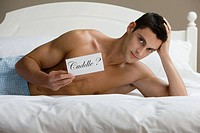 A man reclining on a bed (thumbnail)