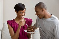 A couple sharing a cake