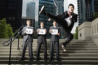Businessman doing martial arts