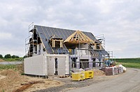 Shell of a building, construction in progress on the roof truss, Eifel, Germany, Europe