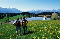 Taking a break from hiking, Hegratsrieder See Lake, Allgaeu, Bavaria, Germany, Europe