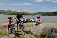 Cyclists at Lake Gruentensee, East Allgaeu, Swabia, Bavaria, Germany, Europe