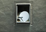Satellite dish with five LNBs mounted in the open window of an apartment building, Duesseldorf, North Rhine-Westphalia, Germany