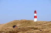 Lighthouse painted red a white standing on grassy hill, Ellenbogen, Sylt Island, North Frisian Islands, Schleswig_Holstein, Germany