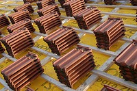 Roofing tiles resting on wooden roof slats at a construction site ready for laying