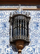 Ornate window of an old manor house in the centre of Seville, Andalusia, Spain