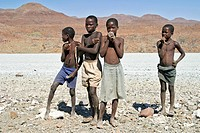 Namibian children selling jewelery on the side of a road in Kaokoveld, northern Namibia, Africa