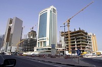 Skyscraper between two construction sites in Doha, Qatar
