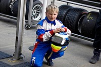 Boy in front of a Formula 3 team tent, 24-hour race at the Nuerburgring racetrack in Nuerburg, Adenau, Rhineland-Palatinate, Germany
