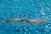 Teenage girls swimming in swimming pool
