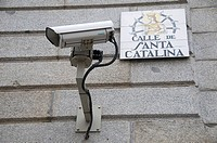 Surveillance camera and street sign, Madrid. Spain