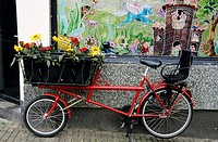 Bicycle with basket for transporting goods and a seat for children, Amsterdam, Netherlands