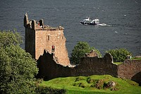 Tourist boat and Urquhart Castle. Loch Ness. Inverness. Scotland