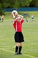 Female soccer player throwing the ball